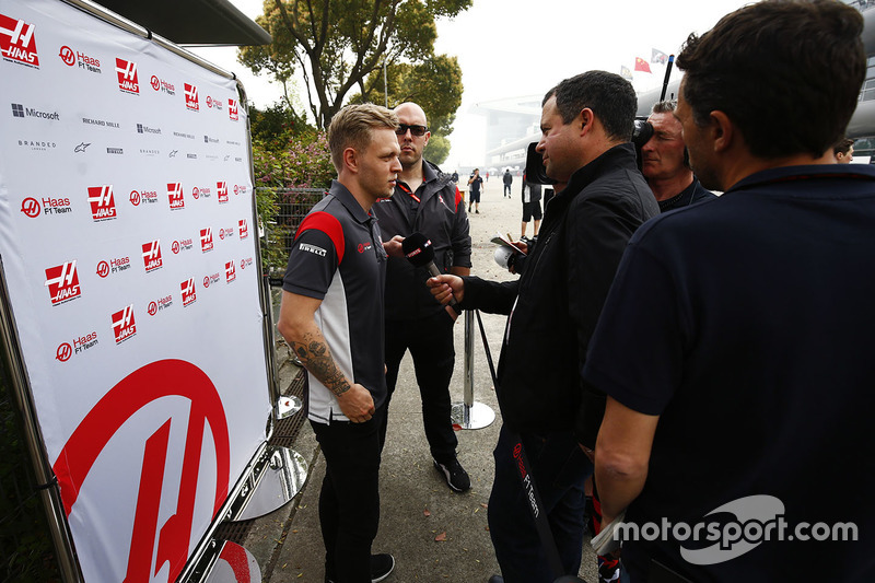 Kevin Magnussen, Haas F1 Team, speaks to the media