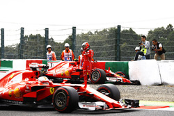 Sebastian Vettel, Ferrari SF70H, passes Kimi Raikkonen, Ferrari SF70H, as he climbs from his car after crashing