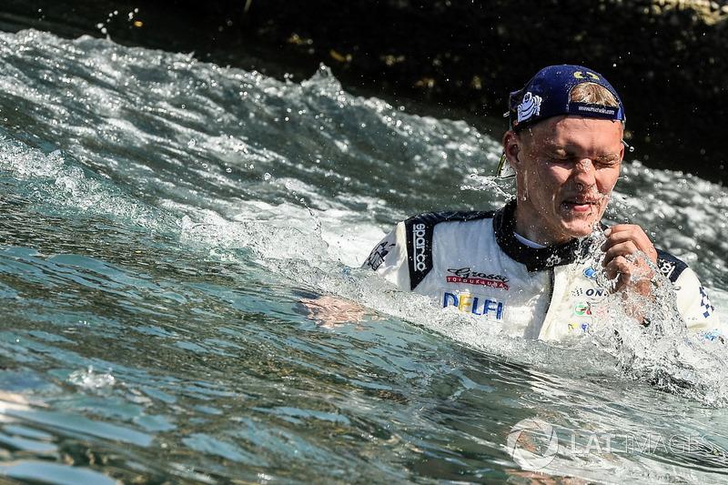 Rally winner Ott Tänak, M-Sport, Ford Fiesta WRCcelebrates in the sea