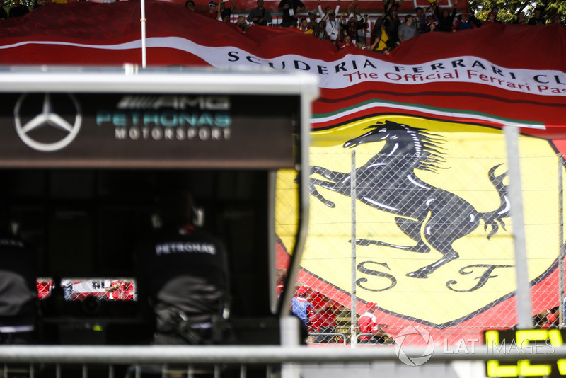 Ferrari flag in the grandstand behind the Mercedes gantry