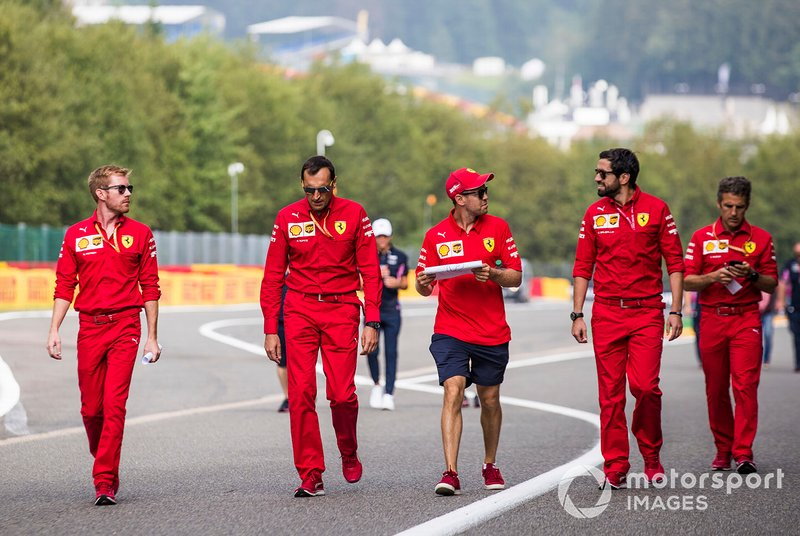 Sebastian Vettel, Ferrari, walks the track with colleagues