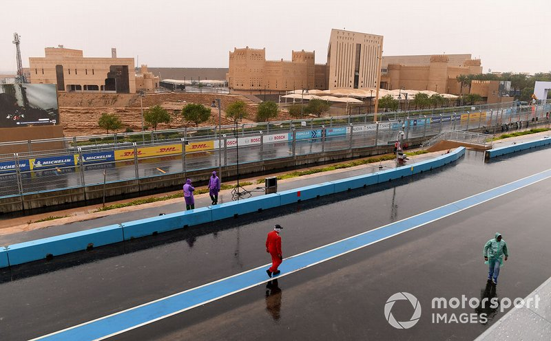 Rain on the circuit, in the pit lane