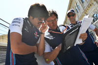 Lance Stroll, Williams Lance Stroll, Williams and Luca Baldisserri, Williams Race Engineer walk the track