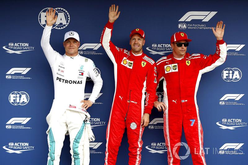 Pole sitter Sebastian Vettel, Ferrari, Valtteri Bottas, Mercedes AMG F1, Kimi Raikkonen, Ferrari