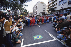 The drivers pay tribute to Ayrton Senna before the race start
