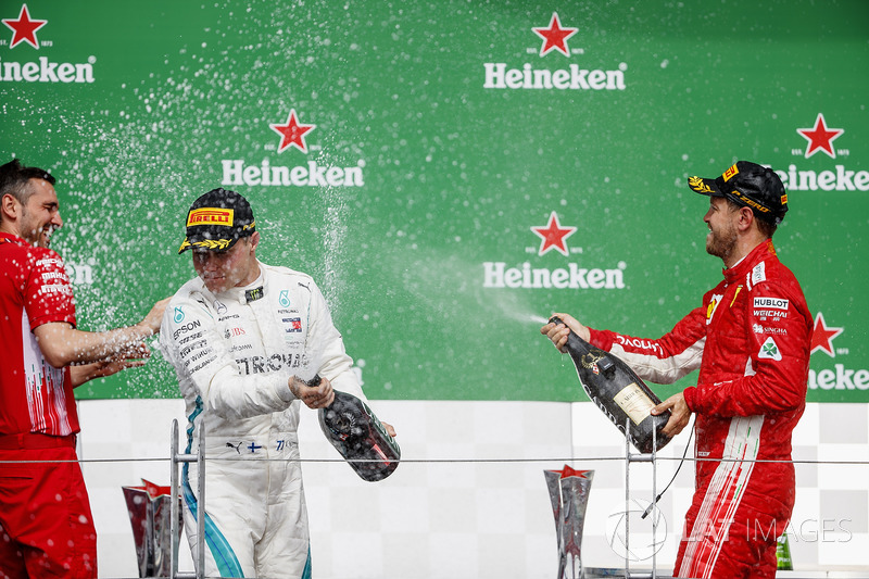 Valtteri Bottas, Mercedes AMG F1, 2nd position, and Sebastian Vettel, Ferrari, 1st position, celebra