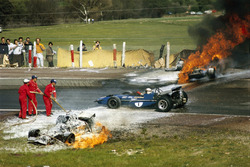 Jackie Oliver's BRM collided with Jacky Ickx's Ferrari. Jackie Stewart is passing the scene of accident