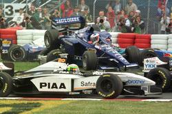 Jarno Trulli, Prost flies through the air before landing on top of Alexander Wurz, Benetton and Ricardo Rosset, Tyrrell