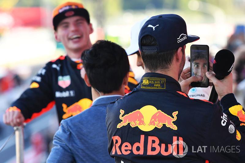 10. Daniel Ricciardo, Red Bull Racing celebrates with Lewis Hamilton's phone on the podium