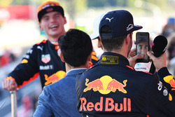 Daniel Ricciardo, Red Bull Racing celebrates with Lewis Hamilton's phone on the podium