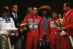 Ayrton Senna, McLaren Honda, 1st position, Alain Prost, McLaren Honda, 2nd position and Stefano Modena, Brabham BT58 Judd, 3rd position celebrate on the podium. McLaren team boss Ron Dennis on the far right