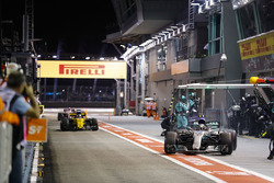 Valtteri Bottas, Mercedes AMG F1 W08, leaves his pit box as Nico Hulkenberg, Renault Sport F1 Team RS17, comes in