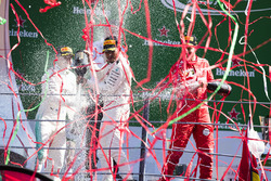 Second place Valtteri Bottas, Mercedes AMG F1, Race winner Third place Lewis Hamilton, Mercedes AMG F1 Sebastian Vettel, Ferrari, celebrate, Champagne on the podium