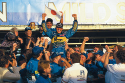 Race winner and World Champion Michael Schumacher, Benetton celebrates with Flavio Briatore and the team