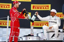 Podium: second place Sebastian Vettel, Ferrari, race winner Lewis Hamilton, Mercedes AMG F1