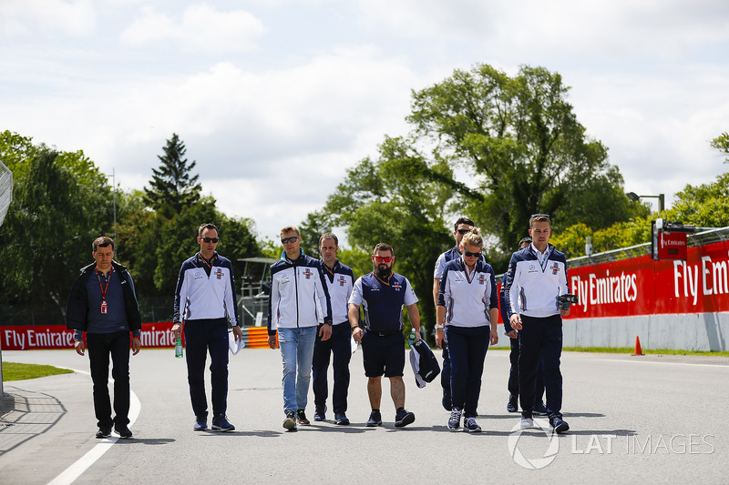 Lance Stroll, Williams Racing, conducts a track walk with colleagues