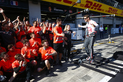 Romain Grosjean, Haas F1 Team, and the Haas F1 team celebrate the team's best finish to date