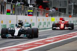 Lewis Hamilton, Mercedes AMG F1 W08, Sebastian Vettel, Ferrari SF70H, in the pits