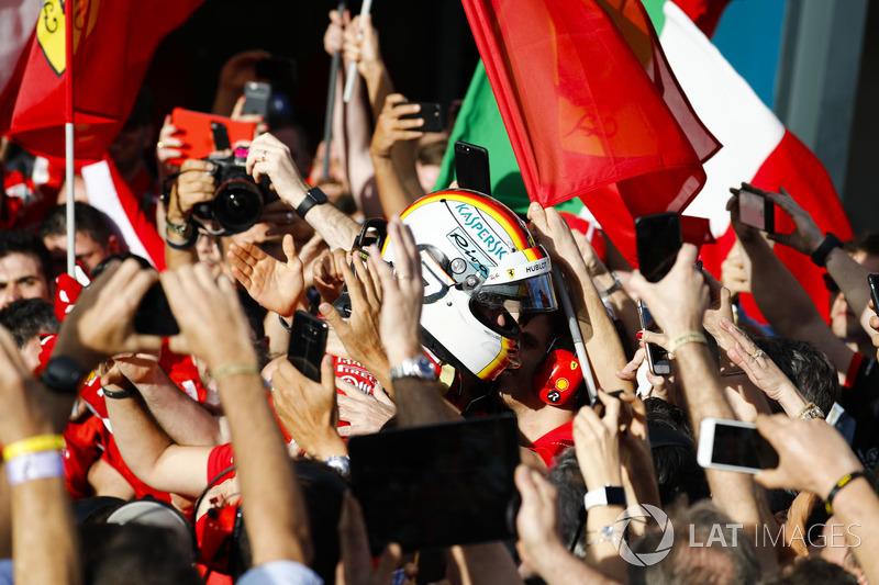 Race winner Sebastian Vettel, Ferrari, celebrates on arrival in Parc Ferme with his team