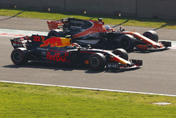 Max Verstappen, Red Bull Racing RB13, drives alongside Fernando Alonso, McLaren MCL32, in FP3