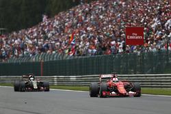 Sebastian Vettel, Ferrari SF-15T, leads Romain Grosjean, Lotus E23 Mercedes