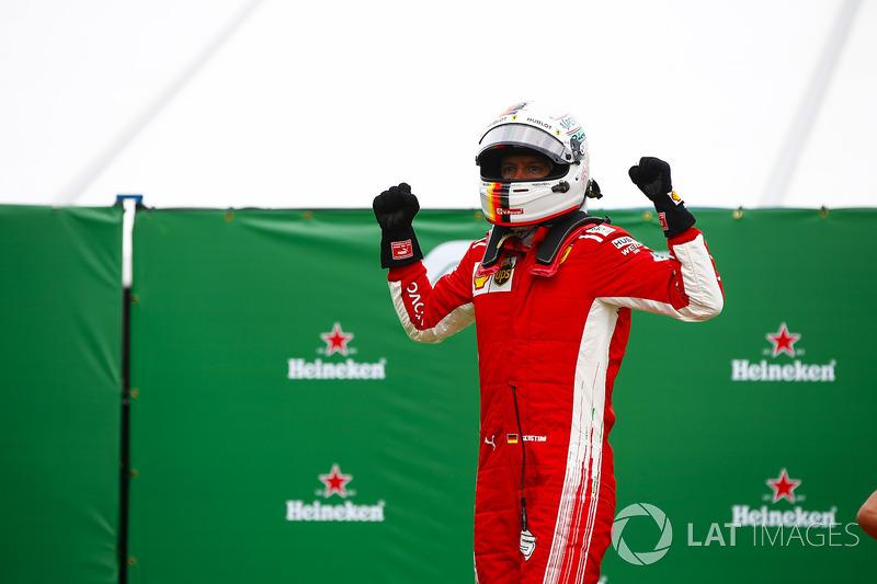 Sebastian Vettel, Ferrari, celebrates victory in parc ferme