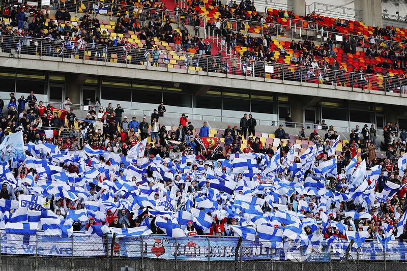 Fans of Kimi Raikkonen, Ferrari, wave Finnish flags