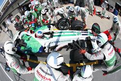 Jenson Button, Honda RA108, makes a stop