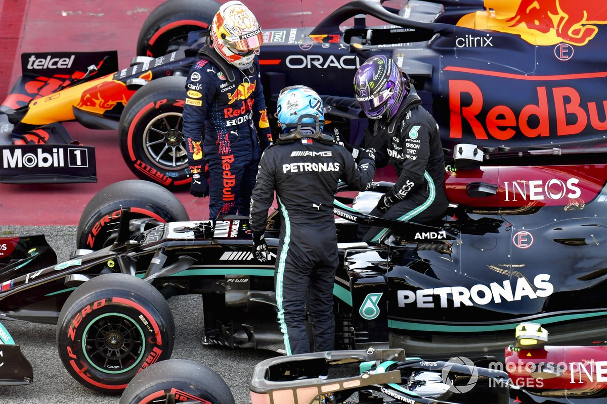 Max Verstappen, Red Bull Racing, and Valtteri Bottas, Mercedes, congratulate Lewis Hamilton, Mercedes, in Parc Ferme after securing his 100th pole in F1