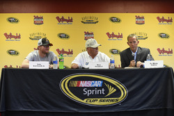 Dr. Micky Collins (R) of the University of Pittsburgh Medical Center Sports Medicine Concussion Program, speaks as Dale Earnhardt Jr. (L) and Rick Hendrick, owner of Hendrick Motorsports listen during a press conference