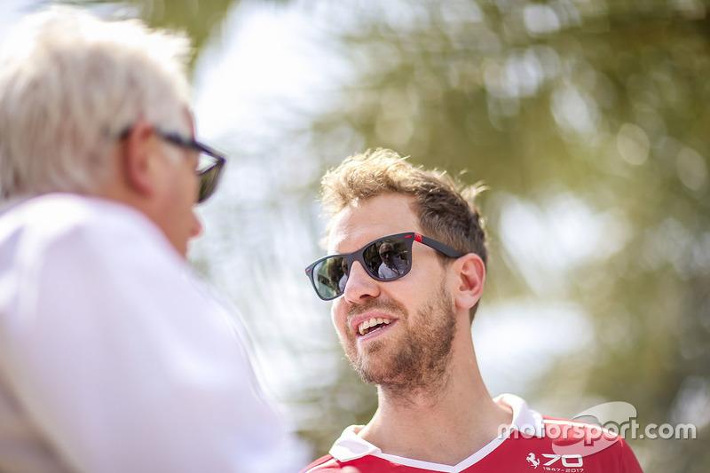 Charlie Whiting, Race Director, FIA, talks with Sebastian Vettel, Ferrari