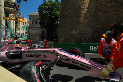 The car of Sergio Perez, Sahara Force India VJM10 is recovered by Marshals after crashing out of First practice session
