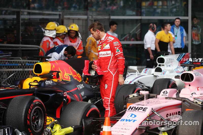 Sebastian Vettel, Ferrari, inspects the car of Daniel Ricciardo, Red Bull Racing RB13, in Parc Ferme after Qualifying