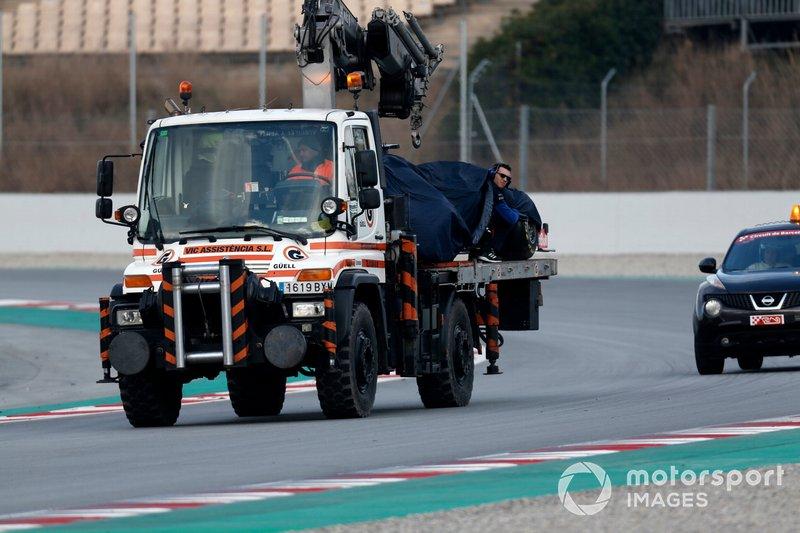 The car of Alex Albon, Scuderia Toro Rosso STR14 is recovered on a truck