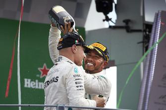 Lewis Hamilton, Mercedes AMG F1, celebrates on the podium, with Valtteri Bottas, Mercedes AMG F1