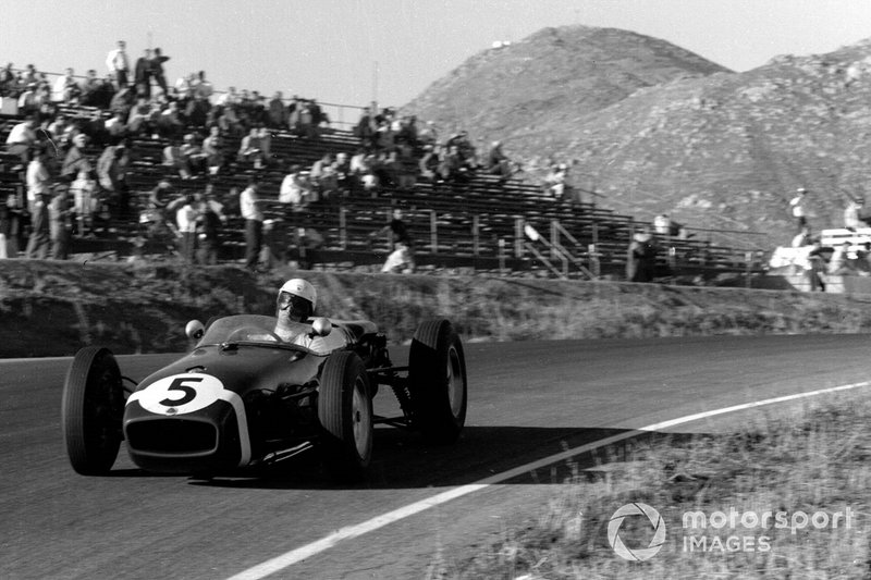 Winning the only U.S. Formula 1 Grand Prix to be held at Riverside, California, in 1960 driving a Lotus 18.