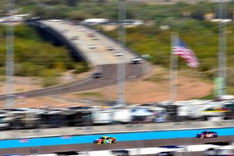 Kyle Busch, Joe Gibbs Racing, Toyota Camry M&M's and Denny Hamlin, Joe Gibbs Racing, Toyota Camry FedEx Ground