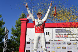 #60 Roush Performance / KohR Motorsports, Ford Mustang GT4, GS: Kyle Marcelli celebrates the win in victory lane