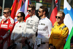 Nico Hulkenberg, Sahara Force India F1 and Jenson Button, McLaren as the grid observes the national