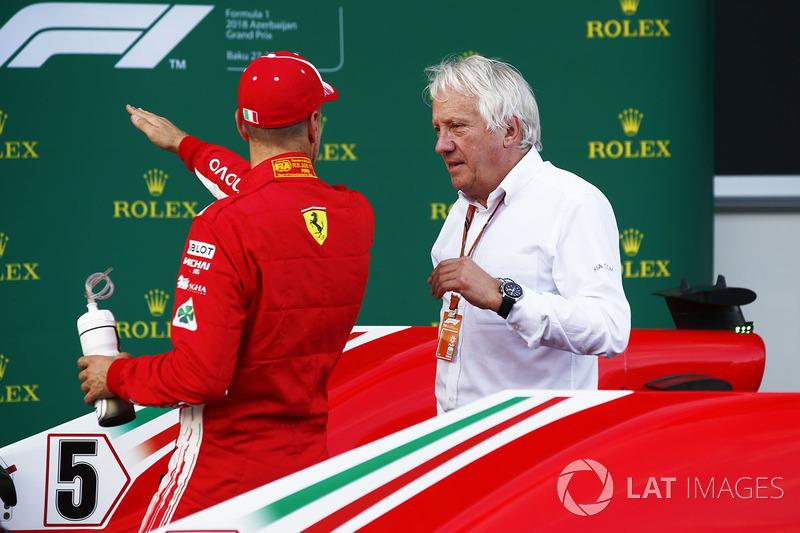 Sebastian Vettel, Ferrari, talks with Charlie Whiting, Race Director, FIA