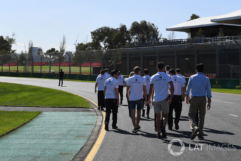 The Alfa Romeo Sauber F1 Team walk the track