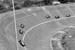 Tony Brooks, Ferrari Dino 246 precede Stirling Moss, Cooper T51 Climax