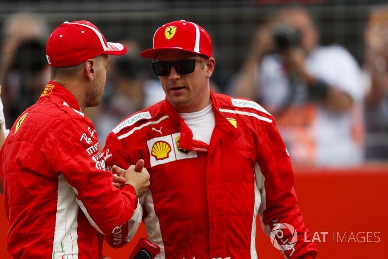 Kimi Raikkonen, Ferrari, congratulates team mate Sebastian Vettel, Ferrari