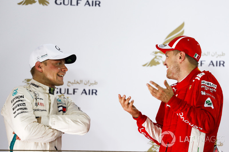 Valtteri Bottas, Mercedes AMG F1, 2nd position, and Sebastian Vettel, Ferrari, 1st position, talk on the podium