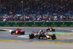 Max Verstappen, Red Bull Racing RB14, leads Kimi Raikkonen, Ferrari SF71H, and Daniel Ricciardo, Red Bull Racing RB14