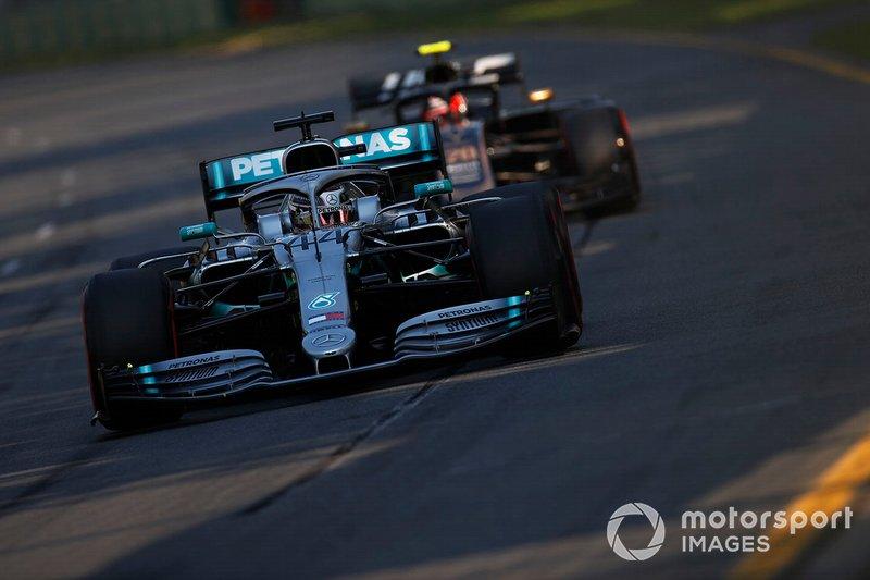 Lewis Hamilton, Mercedes AMG F1 W10, leads Kevin Magnussen, Haas F1 Team VF-19