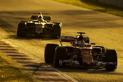 Sebastian Vettel, Ferrari SF70H; Kevin Magnussen, Haas F1 Team VF-17