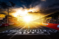 Sunrise on race day over pit straight