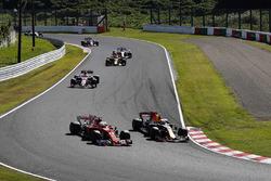 Max Verstappen, Red Bull Racing RB13, passes Sebastian Vettel, Ferrari SF70H, at the start of the race