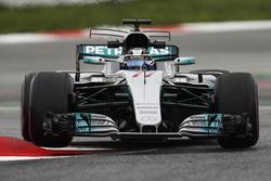 Valtteri Bottas, Mercedes AMG F1 W08, lifts a wheel bouncing over a kerb